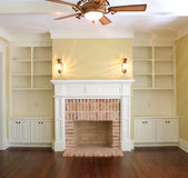 Great room with fireplace. Empty great room with brick fireplace Royalty Free Stock Image