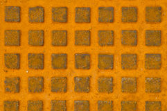 Great rusty iron metal sewer lid background. Royalty Free Stock Photos