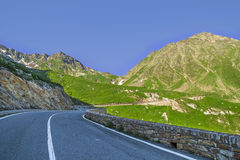 Great Saint Bernard Pass, ancient road along the Aosta Valley. Summer evening on the Great Saint Bernard Pass, ancient road along the Aosta Valley - Alps Stock Photo