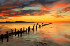 Great Salt Lake sunset  fence posts. Stock Photos