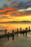 Great Salt Lake sunset pipeline. Royalty Free Stock Image