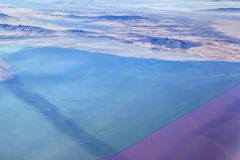 The Great Salt Lake, Utah. A causeway divides the northern from the southern part of the lake. The northern part is more saline and has bacteria that turn the Stock Images