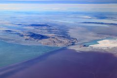The Great Salt Lake, Utah. A causeway divides the northern from the southern part of the lake. The northern part is more saline and has bacteria that turn the Royalty Free Stock Image