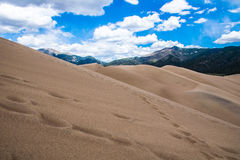 Great Sand Dune National Park Colorado Natural Wonder Sun Beams. Showing through the clouds as the contrast builds over the dunes. The desert landscape of this stock photos