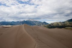 Great Sand Dunes 1. Sand, wind and erosion, with some human tracks, form patterns in the dunes at the Great Sand Dunes National Monument near Alamosa, Colorado Stock Images