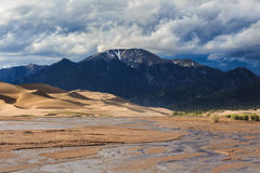 Great Sand Dunes. Medano Creek runs below the Great Sand Dunes in the Mountains of Colorado Royalty Free Stock Images