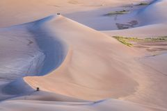 Great Sand Dunes National Park at dawn. Hikers and photographers at sunrise - Great Sand Dunes National Park and Preserve in Colorado Royalty Free Stock Photography