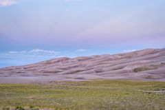 Great Sand Dunes National Park at dawn. Wet sand dunes patterns and texture at dawn - Great Sand Dunes National Park and Preserve in Colorado Stock Photo
