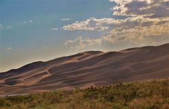 Great Sand Dunes National Park. Dunes stand as high as 750 feet at Great Sand Dunes National Park and Preserve just north of Alamosa, Colorado Stock Photography