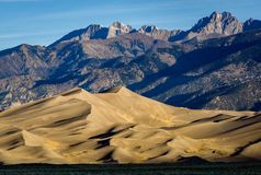 Great Sand Dunes National Park and Preserve. Early morning sunlight on the famous dune field near Alamosa, Colorado Royalty Free Stock Images
