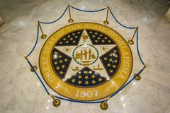 Great seal of the state of Oklahoma on the marble floor of the State Capitol of Oklahoma in Oklahoma City, OK royalty free stock photography