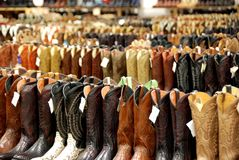 Cowboy Boots in Western Store. Great selection of cowboy boots in retail space royalty free stock photo
