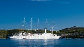 Great ship sailing near shore. Under blue sky in Croatia Stock Photos