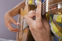 Really great shot capturing detail of a guitarist Royalty Free Stock Image