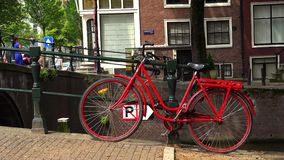 Great shot of a red bicylcle in Amsterdam typical Amsterdam picture City of Amsterdam. Great shot of a red bicylcle in Amsterdam typical Amsterdam picture stock footage