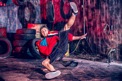 Great skill. Trendy young man dancer dancing in the old garage Royalty Free Stock Images