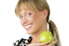 Great smile. Nice blond girl with a green apple on one hand with a great smile Stock Images
