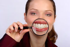 Great smile. Smile and teeth of a beautiful young woman Stock Photography