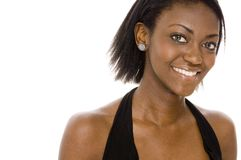 Great Smile. A pretty young african woman in black Stock Images