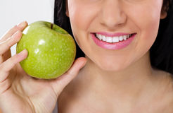 Great smile and green apple Stock Photo