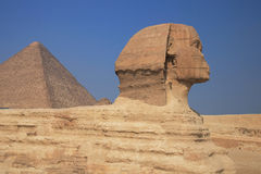 The Great Sphinx. The great egyptian Sphinx of Giza with ancient pyramids on the background Stock Images