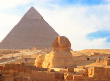 Great Sphinx of Giza. Against the Great Pyramid, Giza, Egypt Stock Photography
