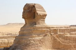 Great Sphinx of Giza. The Great Sphinx of Giza is a limestone statue of a reclining or couchant sphinx that stands on the Giza Plateau on the west bank of the Stock Images