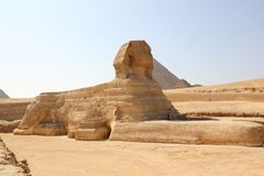 Great Sphinx of Giza. The Great Sphinx of Giza is a limestone statue of a reclining or couchant sphinx that stands on the Giza Plateau on the west bank of the Royalty Free Stock Photo