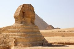 Great Sphinx of Giza. The Great Sphinx of Giza is a limestone statue of a reclining or couchant sphinx that stands on the Giza Plateau on the west bank of the Royalty Free Stock Photos