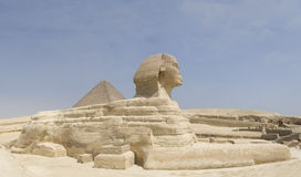 Great Sphinx of Giza. The Great Sphinx of Giza statue with the Pyramid of Khafra behind on the Giza Plateau in Egypt royalty free stock images