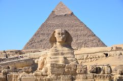 Great Sphinx of Giza against the Pyramid of Khafre. At Giza, Egypt Royalty Free Stock Photo