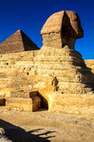 The Great Sphinx of Giza, Cairo, Egypt. This is a picture of the Great Sphinx of Giza, with the Great Pyramid of Giza in the background. Cairo, Egypt Royalty Free Stock Photo