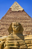 The Great Sphinx of Giza. Egypt. Cairo - Giza. The Sphinx and the Pyramid of Khafre (Chephren) in background. The Pyramid Fields from Giza to Dahshur is on Stock Photos
