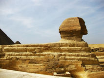 Great Sphinx in the Giza Plateau. Giza is most famous as the location of the Giza Plateau: the site of some of the most impressive ancient monuments in the world royalty free stock photo