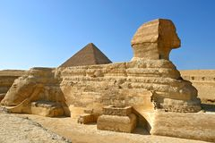 Great Sphinx of Giza with Khafre pyramid - Cairo, Egypt. Great Sphinx of Giza profile with pyramid of Khafre in the background - Cairo, Egypt Stock Image