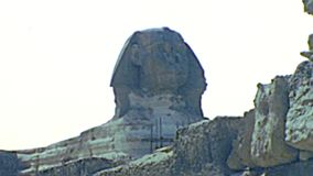 Great Sphinx of Giza with pyramid. Great Sphinx of Giza with the Pyramid of Khafre from Valley Temple of Khafre in Giza Valley Temple. Historical archival of stock video footage