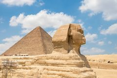 The Great Sphinx of Giza and the pyramid of Khufu stock photo