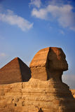The Great Sphinx with the Great Pyramid in the background Royalty Free Stock Image