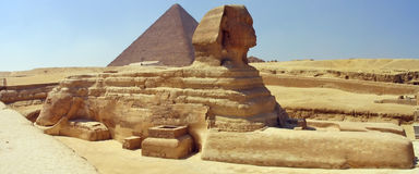 Great Sphinx, Great Pyramid.  Giza, Egypt. A wide panoramic view of the Great Sphinx with Great Pyramid of Khufu in background.  Giza, Egypt Royalty Free Stock Photography
