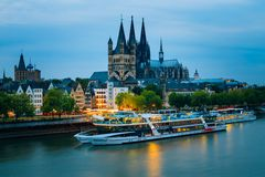 Great St. Martin Church And Dom In Cologne At. COLOGNE, GERMANY - JUNE 17, 2015: Great St. Martin Church And Dom In Cologne At Evening With Reflection In River Royalty Free Stock Photo