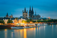 Great St. Martin Church And Dom In Cologne. COLOGNE, GERMANY - JUNE 17, 2015: Great St. Martin Church And Dom In Cologne At Evening With Reflection In River Royalty Free Stock Image