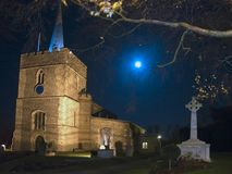 Great St Mary`s Church in Sawbridgeworth. Great St Mary`s Church in Sawbridgeworth, Hertfordshire at night while a service is in progress. on the right is the royalty free stock photo