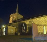 Great St Mary`s Church in Sawbridgeworth. Great St Mary`s Church in Sawbridgeworth, Hertfordshire at night while a service is in progress. on the right are some royalty free stock images