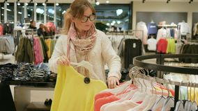 Great store of designer things happiness for a woman shopaholic, Close-up of female shopper, Choice of fashion clothes