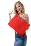 Great stuff in here. Woman advertising blank red shopping bag Stock Photo