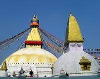 Great Stupa of Boudhanath Kathmandu Nepal with Prayer Flags. Eyes of Buddha above white and gold dome of Great Stupa of Boudhanath, Kathmandu, Nepal, one of the Royalty Free Stock Image