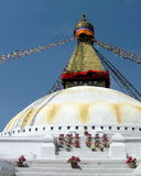 Great Stupa of Boudhanath Kathmandu Nepal with Prayer Flags. Eyes of Buddha above white and gold dome of Great Stupa of Boudhanath, Kathmandu, Nepal, one of the Stock Images