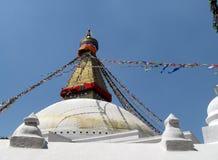 Great Stupa of Boudhanath Kathmandu Nepal with Prayer Flags. Eyes of Buddha above white and gold dome of Great Stupa of Boudhanath, Kathmandu, Nepal, one of the Royalty Free Stock Photo