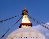 Great Stupa of Boudhanath Kathmandu Nepal with Prayer Flags. Eyes of Buddha above white and gold dome of Great Stupa of Boudhanath, Kathmandu, Nepal, one of the Royalty Free Stock Photos