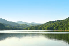 Great summer lake with green forests and mountains. Summer blue lake with green forests and mountains Stock Photography